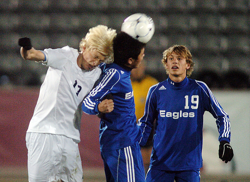 Alex Tagawa, center, Broomfield, with back up from Blake Seitz, collides with Ryan Dozier, Air Academy during Wednesday's state 4A championship game at Dick's Sporting Goods Park in Commerce City.<br /> November 10, 2010<br /> staff photo/David R. Jennings