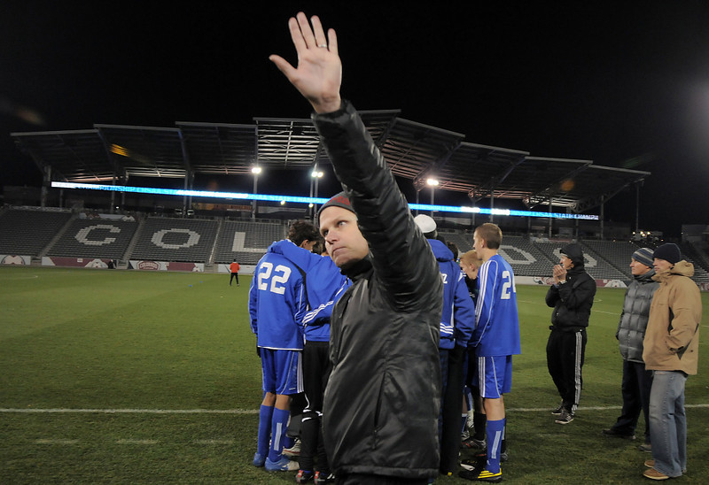 Broomfield's coach Jim Davidson waves at the fans after the Eagles  lost to Air Academy in the state 4A championship game at Dick's Sporting Goods Park in Commerce City on Wednesday.<br /> November 10, 2010<br /> staff photo/David R. Jennings