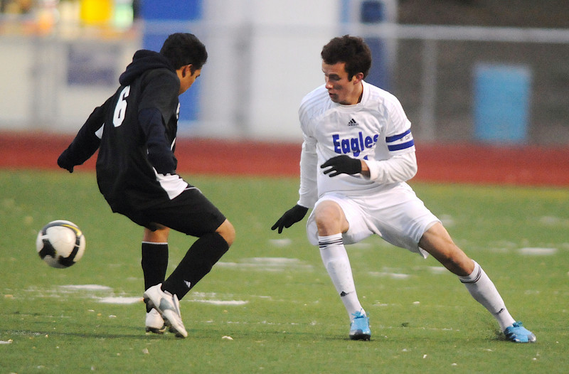 Cole Chapleski, right, Broomfield, maneuvers the ball around  Harrison's Jonathan Sanchez during the game on Tuesday at Elizabeth Kennedy Stadium.<br /> <br /> October 27, 2009<br /> Staff photo/David R. Jennings