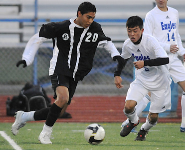 Alex Tagawa, right, Broomfield, fights for the ball against Ivan Nunez, Harrison, during the game on Tuesday at Elizabeth Kennedy Stadium.  October 27, 2009 Staff photo/David R. Jennings