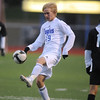 Will Roberts, Broomfield, kicks the ball away from Gerardo Lopez-Perez, Harrison, during the game on Tuesday at Elizabeth Kennedy Stadium.<br /> <br /> October 27, 2009<br /> Staff photo/David R. Jennings