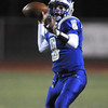 Quarterback Aric Kaiser, Broomfield, looks for an open receiver during Friday's game against Loveland at Elizabeth Kennedy Stadium.<br /> <br /> October 23, 2009<br /> Staff photo/David R. Jennings