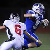 Dan Guebelle,  Broomfield, runs downfield away from A.J. Steele,  Loveland during Friday's game at Elizabeth Kennedy Stadium.<br /> <br /> October 23, 2009<br /> Staff photo/David R. Jennings