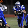Sean Gentry, Broomfield, works his way through a hole in the line during Friday's game against Loveland  at Elizabeth Kennedy Stadium.<br /> <br /> October 23, 2009<br /> Staff photo/David R. Jennings