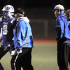 Broomfield's quarterback Aric Kaiser, left, gets instructions from head coach Gary Davies during Friday's game against Loveland at Elizabeth Kennedy Stadium.<br /> <br /> October 23, 2009<br /> Staff photo/David R. Jennings