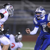 Quarterback Aric Kaiser,  Broomfield, tries to move away from Kyle Klein, Loveland during Friday's game at Elizabeth Kennedy Stadium.<br /> <br /> October 23, 2009<br /> Staff photo/David R. Jennings