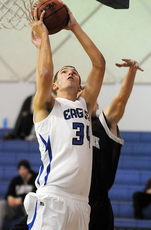 Nick Halliday, Broomfield goes for two against Silver Creek during Tuesday's game at Broomfield.<br /> <br /> <br /> December 15, 2009<br /> Staff photo/David R. Jennings
