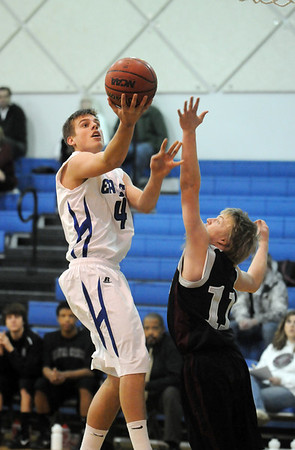 Aric Kaiser, left, Broomfield goes to the basket past Teagan Kramer, Silver Creek during Tuesday's game at Broomfield.<br /> <br /> <br /> December 15, 2009<br /> Staff photo/David R. Jennings