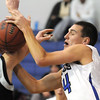 Nick Halliday, right, Broomfield, collides with Mike Grimmer, Silver Creek under the basket during Tuesday's game at Broomfield.<br /> <br /> <br /> December 15, 2009<br /> Staff photo/David R. Jennings