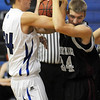 Broomfield's Nick Halliday, left, fights for control of the ball with Mike Grimmer, Silver Creek during Tuesday's game at Broomfield.<br /> <br /> <br /> December 15, 2009<br /> Staff photo/David R. Jennings