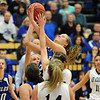 Broomfield's Meagan Prins reaches for the ball over Air Academy during Saturday's girls 4A state great eight playoff game at the Colorado School of Mines.<br /> March 2, 2012 <br /> staff photo/ David R. Jennings