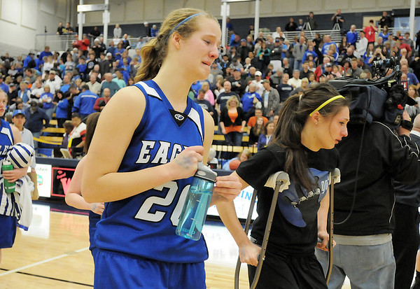Meagan Prins, left, cries and walks off the court with injured teammate Brittney Zec after Broomfield's loss to Air Academy in Saturday's girls 4A state great eight playoff game at the Colorado School of Mines.<br /> March 2, 2012 <br /> staff photo/ David R. Jennings