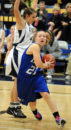 Broomfield's Nicole Lehrer goes to the basket past Air Academy's Erin Todd during Saturday's girls 4A state great eight playoff game at the Colorado School of Mines.<br /> March 2, 2012 <br /> staff photo/ David R. Jennings
