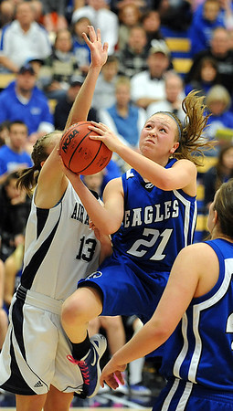 Broomfield's Nicole Lehrer goes to the basket against Air Academy's Kellyn Roiko during Saturday's girls 4A state great eight playoff game at the Colorado School of Mines.<br /> March 2, 2012 <br /> staff photo/ David R. Jennings