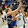 Broomfield's Meagan Prins reaches for the ball against Air Academy's Brittany Hernandez during Saturday's girls 4A state great eight playoff game at the Colorado School of Mines.<br /> March 2, 2012 <br /> staff photo/ David R. Jennings
