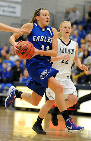 Broomfield's Katie Croell charges to the basket past Air Academy's Tori Reifschnieder during Saturday's girls 4A state great eight playoff game at the Colorado School of Mines.<br /> March 2, 2012 <br /> staff photo/ David R. Jennings