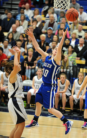 Broomfield's Brianna Wilber goes to the basket against Air Academy's Erin Todd during Saturday's girls 4A state great eight playoff game at the Colorado School of Mines.<br /> March 2, 2012 <br /> staff photo/ David R. Jennings