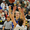 Broomfield's Meagan Prins shoots to the basket past Air Academy's Miranda Beal during Saturday's girls 4A state great eight playoff game at the Colorado School of Mines.<br /> March 2, 2012 <br /> staff photo/ David R. Jennings