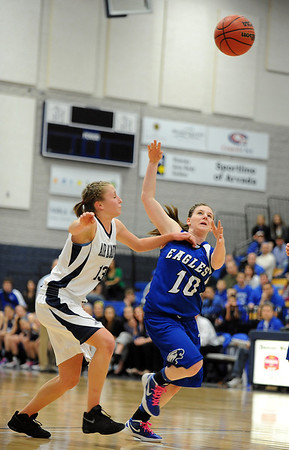 Broomfield's Brianna Wilber runs after a loose ball against Air Academy's Kellyn Roiko during Saturday's girls 4A state great eight playoff game at the Colorado School of Mines.<br /> March 2, 2012 <br /> staff photo/ David R. Jennings