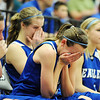 Broomfield's Katie Croell, center, cries with Meagan Prins, center left, after loosing to Air Academy in Saturday's girls 4A state great eight playoff game at the Colorado School of Mines.<br /> March 2, 2012 <br /> staff photo/ David R. Jennings