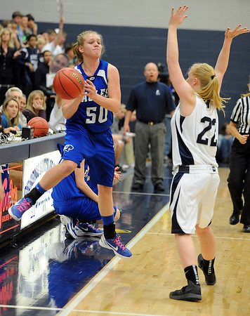 Broomfield's Callie Kaiser, left, tries to keep the ball inbounds from  Air Academy's xxx Tori Reifschnieder during Saturday's girls 4A state great eight playoff game at the Colorado School of Mines.<br /> March 2, 2012 <br /> staff photo/ David R. Jennings