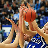 Broomfield's Katie Croell, right, and Meagan Prins fight for the ball under the basket against Air Academy during Saturday's girls 4A state great eight playoff game at the Colorado School of Mines.<br /> March 2, 2012 <br /> staff photo/ David R. Jennings