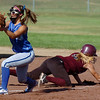 Kalie Knudson, left, third base Broomfield High, catches the ball while Amy Ekhart, Berthoud High, slides back to third during play at Broomfield on Thursday. <br /> <br /> August 27, 2009<br /> staff photo/David R. Jennings