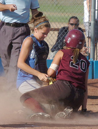 Catcher Sarah Fabrizio, left, Broomfield High, tags out Victoria Puchino, Berthoud High during play at Broomfield on Thursday. <br /> <br /> August 27, 2009<br /> staff photo/David R. Jennings