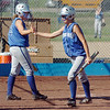 Broomfield High's Kristin Bamberger, left, congratulates Sarah Fabrizio on scoring a run against  Berthoud High during play at Broomfield on Thursday. <br /> <br /> August 27, 2009<br /> staff photo/David R. Jennings