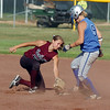 Courtney Derus, right, Broomfield High, avoids a tag by Amy Ekart, Berthoud High during play at Broomfield on Thursday. <br /> <br /> August 27, 2009<br /> staff photo/David R. Jennings