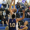 "Dan Perse, Broomfield, makes a basket past Steven Jordan and Sam Esler, Centaurus, during Friday's game at Broomfield. <br /> For more photos please see  <a href=""http://www.broomfieldenterprise.com"">http://www.broomfieldenterprise.com</a><br /> January 19, 2012<br /> staff photo/ David R. Jennings"
