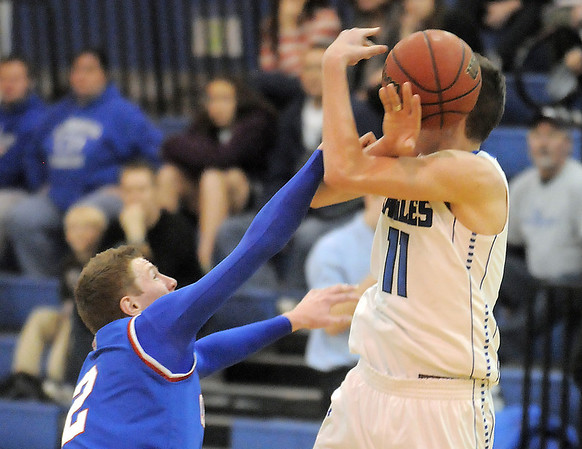 """Nate McGinley, Centaurus, and Spenser Reeb, Broomfield, fight for the ball during Friday's game at Broomfield. <br /> For more photos please see  <a href=""""http://www.broomfieldenterprise.com"""">http://www.broomfieldenterprise.com</a><br /> January 19, 2012<br /> staff photo/ David R. Jennings"""
