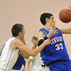 "Austin Tunquist, Centaurus, reaches for the ball against Spenser Reeb,Broomfield, during Friday's game at Broomfield. <br /> For more photos please see  <a href=""http://www.broomfieldenterprise.com"">http://www.broomfieldenterprise.com</a><br /> January 19, 2012<br /> staff photo/ David R. Jennings"