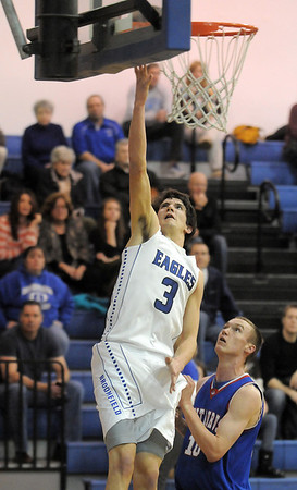 "Nick Orgarato, Broomfield, goes to the basket against Steven Jordan, Centaurus during Friday's game at Broomfield. <br /> For more photos please see  <a href=""http://www.broomfieldenterprise.com"">http://www.broomfieldenterprise.com</a><br /> January 19, 2012<br /> staff photo/ David R. Jennings"