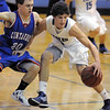 "Nick Ongarato, Broomfield, drives the ball down court against Trevor Schrader, Centaurus during Friday's game at Broomfield. <br /> For more photos please see  <a href=""http://www.broomfieldenterprise.com"">http://www.broomfieldenterprise.com</a><br /> January 19, 2012<br /> staff photo/ David R. Jennings"