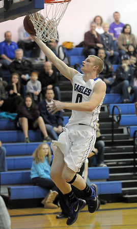 """Dan Perse, Broomfield, makes a basket against Centaurus during Friday's game at Broomfield. <br /> For more photos please see  <a href=""""http://www.broomfieldenterprise.com"""">http://www.broomfieldenterprise.com</a><br /> January 19, 2012<br /> staff photo/ David R. Jennings"""