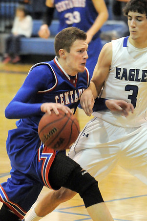 """Nate McGinley, Centaurus, dribbles the ball against Nick Ongarato, during Friday's game at Broomfield. <br /> For more photos please see  <a href=""""http://www.broomfieldenterprise.com"""">http://www.broomfieldenterprise.com</a><br /> January 19, 2012<br /> staff photo/ David R. Jennings"""