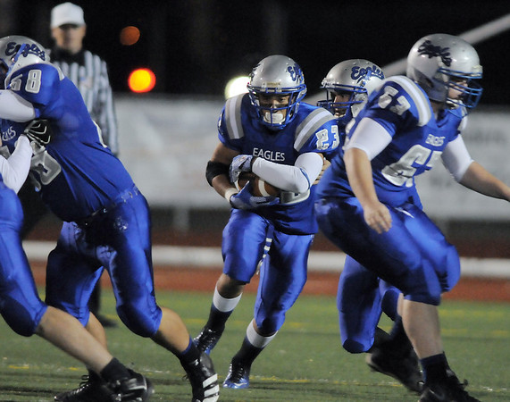 Broomfield's Jose Faire carries the ball downfield against Cheyenne Mountain during Friday's first round state 4A playoff game at Elizabeth Kennedy Stadium.<br /> <br /> November 11, 2011<br /> staff photo/ David R. Jennings