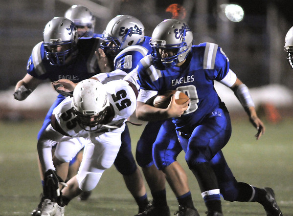 Broomfield's quarterback Angelo Perez runs the ball downfield braking  a tackle by Cheyenne Mountain's Patrick Callahan during Friday's first round state 4A playoff game at Elizabeth Kennedy Stadium.<br /> <br /> November 11, 2011<br /> staff photo/ David R. Jennings