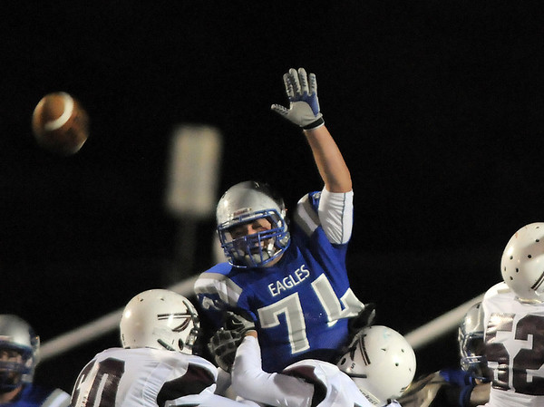 Broomfield's Jimmy Roberts nearly blocks a kick by Cheyenne Mountain during Friday's first round state 4A playoff game at Elizabeth Kennedy Stadium.<br /> <br /> November 11, 2011<br /> staff photo/ David R. Jennings
