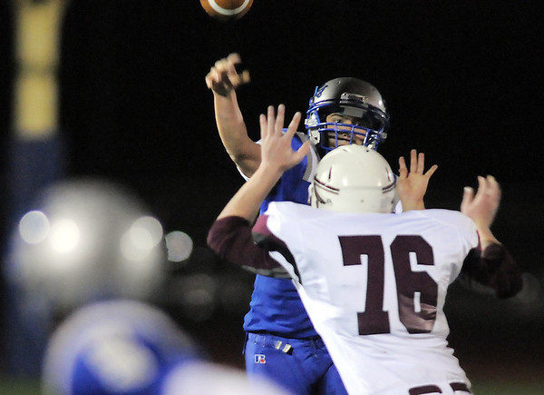 Broomfield's quarterback Angelo Perez passes the ball over Cheyenne Mountain's Brian Frachiseur during Friday's first round state 4A playoff game at Elizabeth Kennedy Stadium.<br /> <br /> November 11, 2011<br /> staff photo/ David R. Jennings