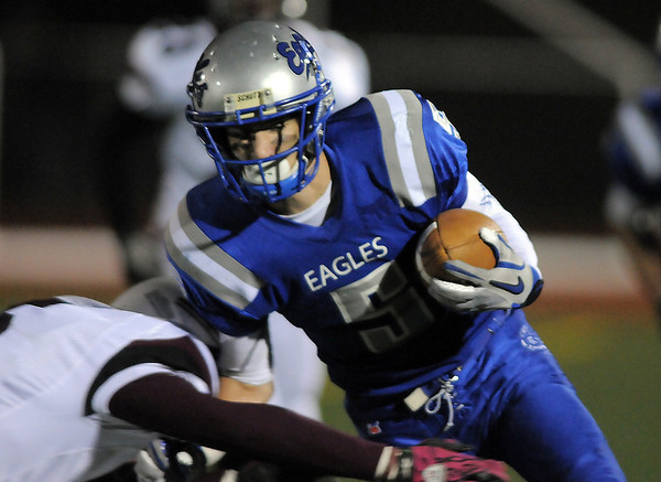 Broomfield's Nick Ongarato runs the ball against Cheyenne Mountain after catching a pass during Friday's first round state 4A playoff game at Elizabeth Kennedy Stadium.<br /> <br /> November 11, 2011<br /> staff photo/ David R. Jennings