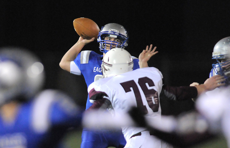 Broomfield's quarterback Angelo Perez passes the ball over Cheyenne Mountain's Brian Frachiseur during Friday's first round state 4A playoff game at Elizabeth Kennedy Stadium.<br /> November 11, 2011<br /> staff photo/ David R. Jennings