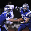 Broomfield's quarterback Angelo Perez fakes a handoff to Jose Faire  during Friday's first round state 4A playoff game against Cheyenne Mountain at Elizabeth Kennedy Stadium.<br /> <br /> November 11, 2011<br /> staff photo/ David R. Jennings