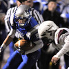 Broomfield's Nick Ongarato, after catching a pass, is driven off the field by Cheyenne Mountain's  Jeremy Grooms during Friday's first round state 4A playoff game at elizabeth Kennedy Stadium.<br /> <br /> November 11, 2011<br /> staff photo/ David R. Jennings