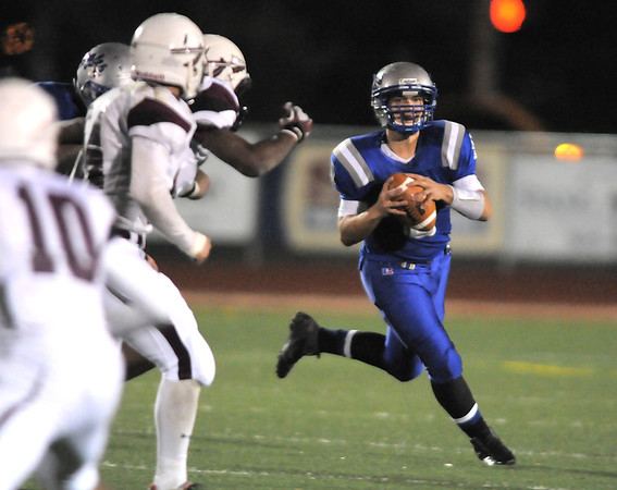 Broomfield's quarterback Angelo Perez prepares to pass against Cheyenne Mountain during Friday's first round state 4A playoff game at Elizabeth Kennedy Stadium.<br /> <br /> November 11, 2011<br /> staff photo/ David R. Jennings