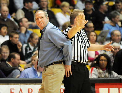 Broomfield's head coach Mike Croell, left, demonstrates to a ref as he argues against a call during the game against  Conifer at the Final Four game at the Coors Event Center in Boulder on Wednesday   March 10, 2010 Staff photo/David R. Jennings
