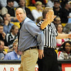 Broomfield's head coach Mike Croell, left, demonstrates to a ref as he argues against a call during the game against  Conifer at the Final Four game at the Coors Event Center in Boulder on Wednesday <br /> <br /> March 10, 2010<br /> Staff photo/David R. Jennings