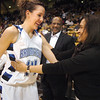 Broomfield's Katie Nehf, left. hugs and talks to Beverly Porter, right, and Lonnie Porter, center, her father  coach from Regis University, after the Eagles defeated Conifer 59 to 32 during the Final Four game at the Coors Event Center in Boulder on Wednesday. <br /> Nehf's father passed away earlier this year.<br /> <br /> March 10, 2010<br /> Staff photo/David R. Jennings