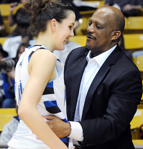 Broomfield's Katie Nehf  chats with Lonnie Porter, her father's coach from Regis University, after the Eagles defeated Conifer 59 to 32 during the Final Four game at the Coors Event Center in Boulder on Wednesday  Nehf's father passed away earlier this year. March 10, 2010 Staff photo/David R. Jennings